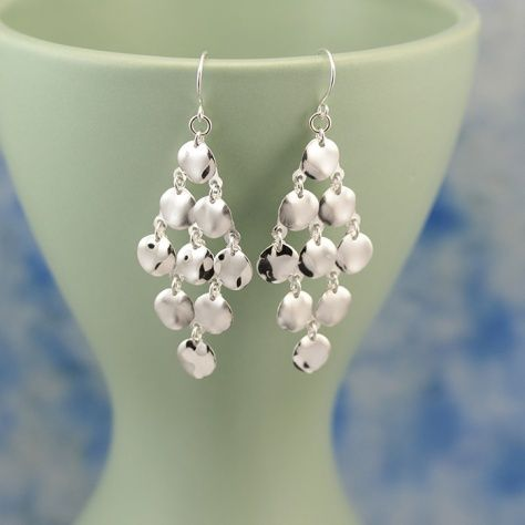 Waterfall Earrings £18.00 Shimmering coins of sterling silver make for some very stunning earrings All of our silver jewellery comes packaged in a pretty gift box. Sterling Silver Size: 23 X 60 mm drop