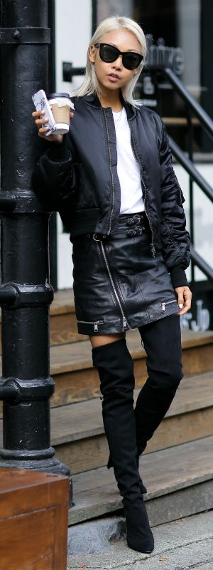 This zip detailed leather mini skirt looks totally hardcore worn with a pair of over the knee boots. Black bomber jackets are also a must have   this season. Via Vanessa Hong.  Jacket: NBY, Tee: Uniqlo, Skirt: Topshop, Boots: Stuart Weitzman.