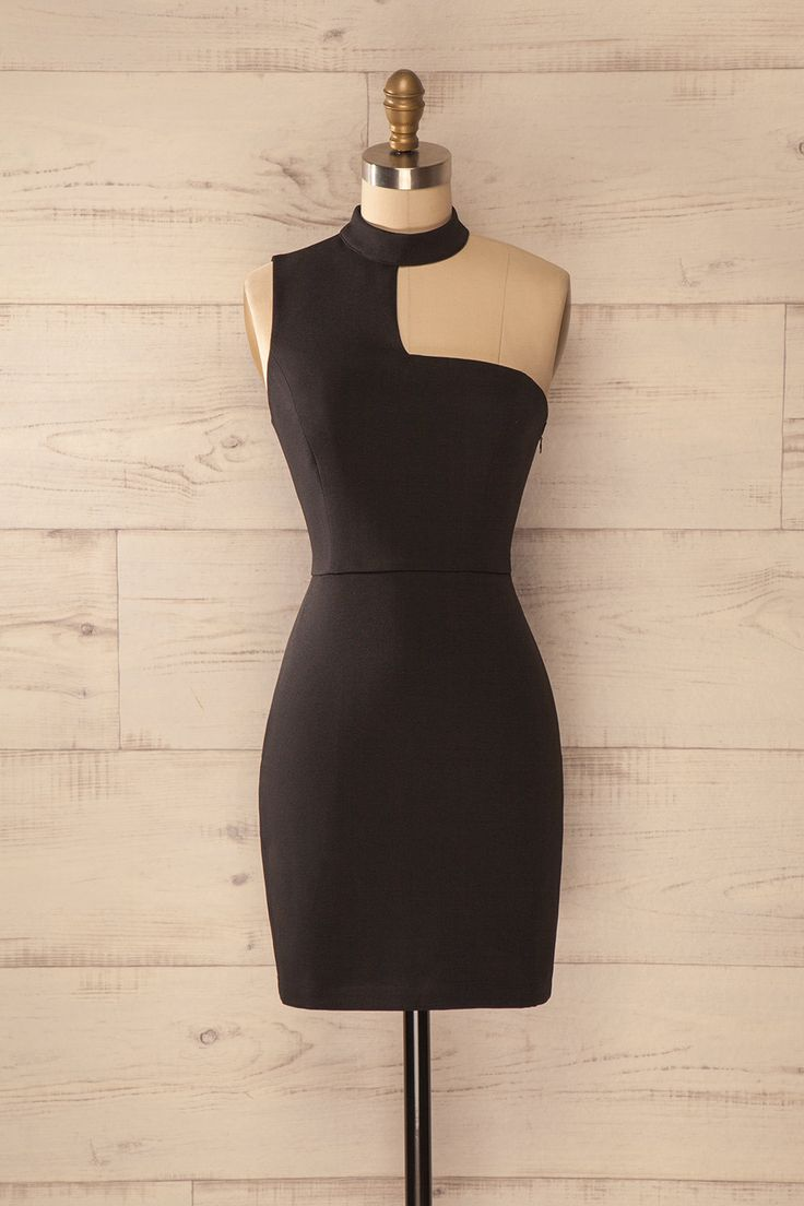 L'audace des Bond Girls est à la portée de tous ! Everyone may share the boldness of the Bond Girls! Black asymmetrical stand collar dress www.1861.ca