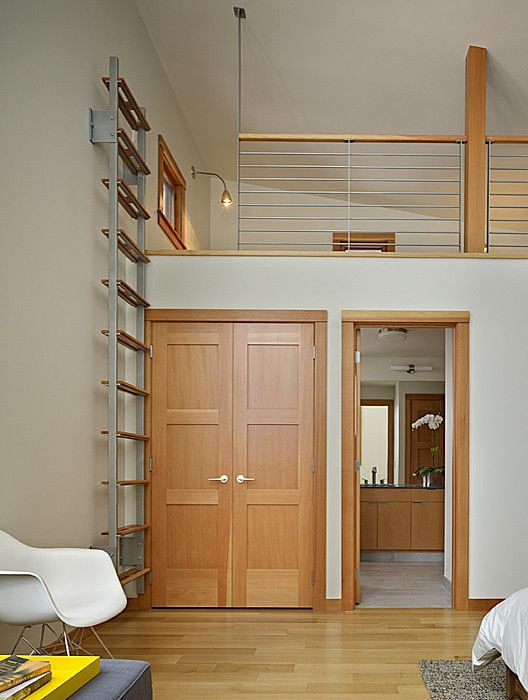vertical stairs into loft bedroom above bathroom North Lake Wenatchee Cabin by DeForest Architects