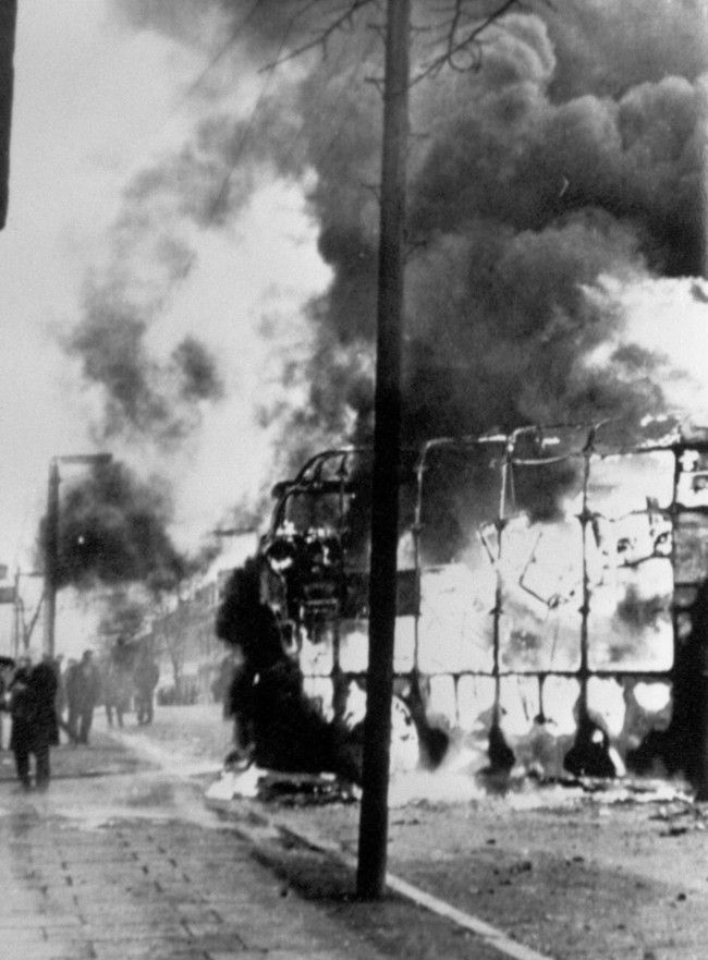 Flames leap into the air from a double decker bus when rioters used it as a blazing barricade in the Roman Catholic Falls Road area of Belfast. Violence broke out in Springfield Road after police and troops carried out an arms  Date: 03/02/1971