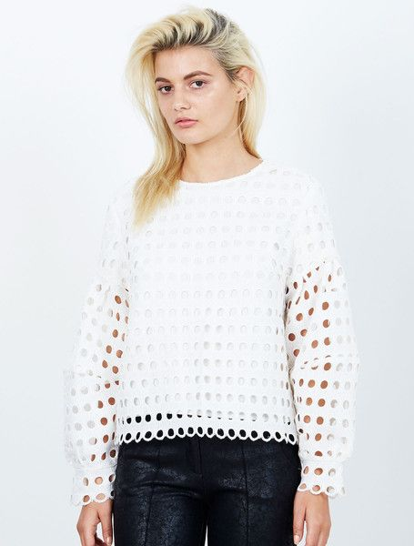 ISLA MANHATTAN L/S TOP WHITE from the Tribeca Collection. Giving broderie anglaise a contemporary spin this boxy sweater crops just below the waist, with playful cuff detailing that contrasts with the edginess of a peak-a-boo finish. Partially lined, with an exposed gold zip at the back. Available: www.islalabel.com  #islalabel #fashion #style #winter #top #sweater #white
