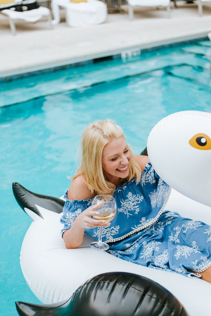 Pool floats for kids! I love this oversized pelican pool float more than the oversized swan float! I floated on him in the pool in my new blue ruffled off the shoulder dress with a glass of wine. Because summer is too short to not have a pool party!