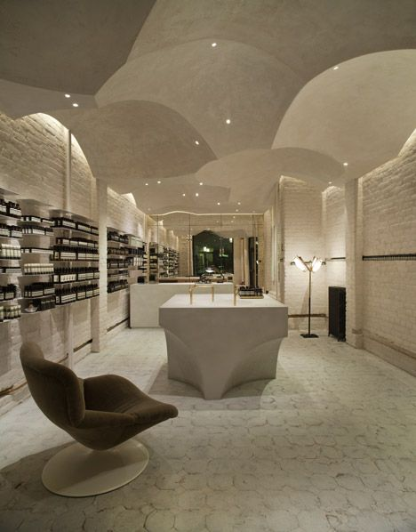Oslo Aesop store by Snøhetta: matte gypsum plaster ceiling referencing Orthodox churches and monasteries.