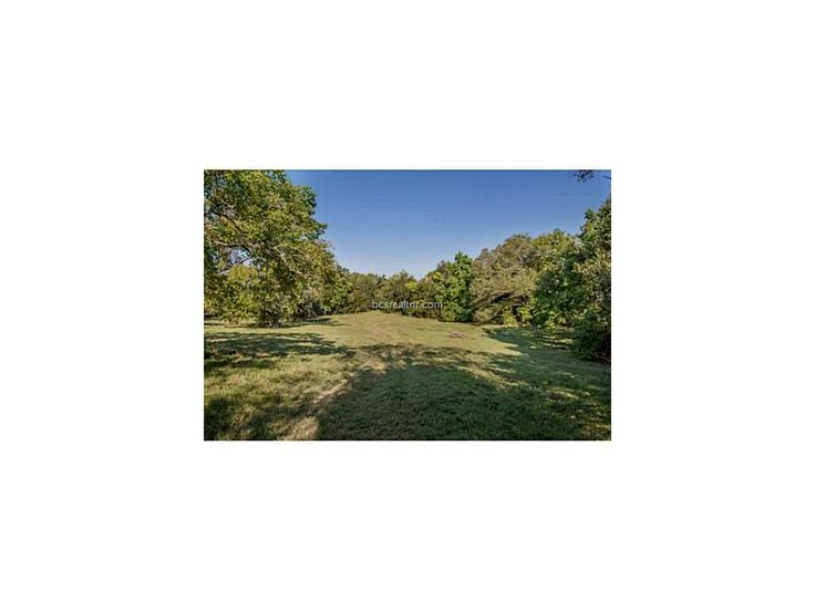 15818 HIGHWAY 21 North Zulch TX 77872 by RE/MAX Bryan College Station 102140 Chance to own beautiful farm & ranch land close to Bryan! This ranch offers 3 living quarters, 5000sqft metal shop and barn on 165+/- beautiful rolling acres in Madison County. Several stock tanks dot the property and is bordered on west side by Shepherd Creek. Large scattered hardwoods and plenty of improved grazing available for cattle and/or horses as well as a well producing hay patch. Price: $1,275,000