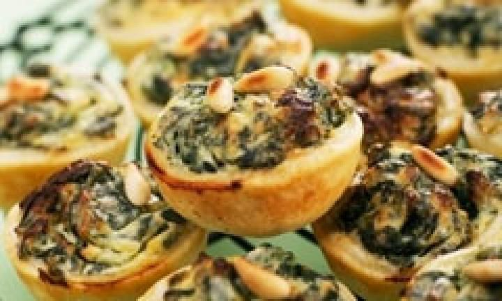 Mini quiches are great for easy entertaining. Try these spinach and pine nut quiches using puff pastry - or jazz up this recipe with other fillings like mushroom, chive and goat's cheese or even smoked salmon, preserved lemon and feta.