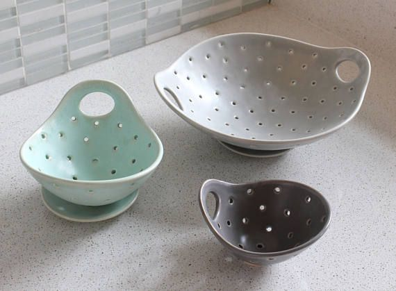 Such a sweet bowl! This is a cup sized colander for washing berries. This is perfect for washing off single servings of fruits or veggies to add to your meals. I threw this on the wheel out of white stoneware, and then carved the rim down to create a handle and nice wavey rim. I then