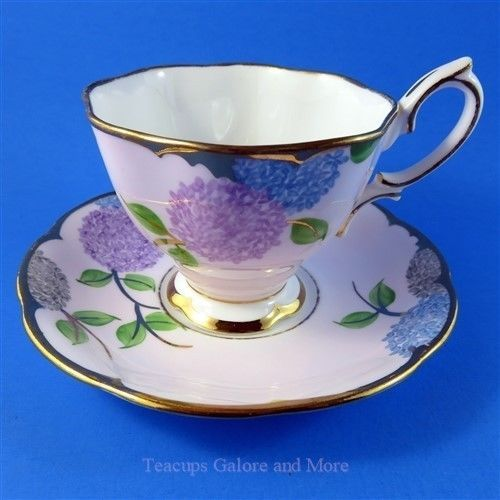 Royal Albert Purple and Blue Floral on Pink Tea Cup and Saucer Set