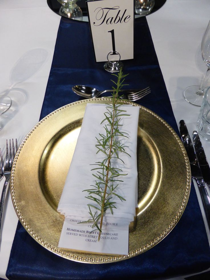 Love the gold plates with rosemary sprigs
