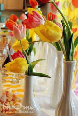 Tulips in white vases for a baby shower.