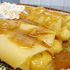 Banana Crepes - French crepes filled with a sweet cream sauce over bananas and topped with whipped cream.