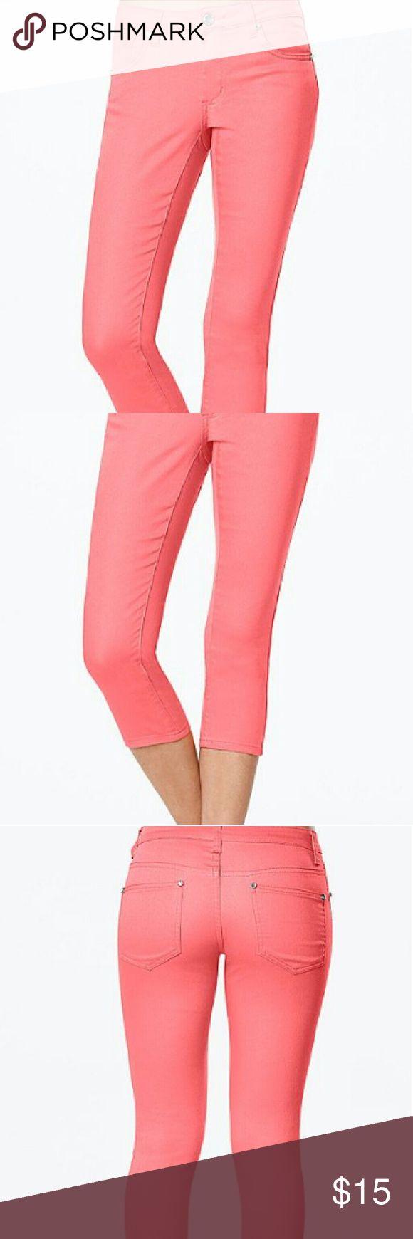 Capri jeans coral Capri jeans .Jeweled button closure and rivets Pants Capris