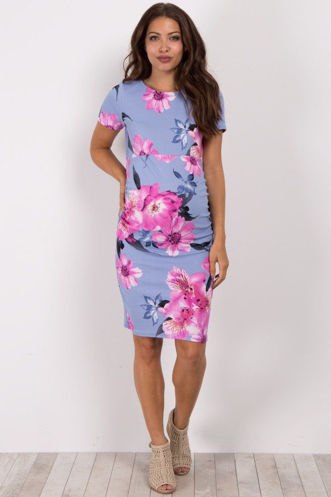 22c143b2a2 A floral print short sleeve fitted maternity dress. Ruched sides. Rounded  neckline.