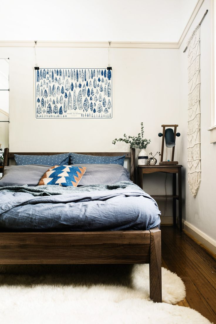 Incredibly, this gorgeous wooden bed was an affordable Ikea find! + blue  linens, bed side table, print over bed