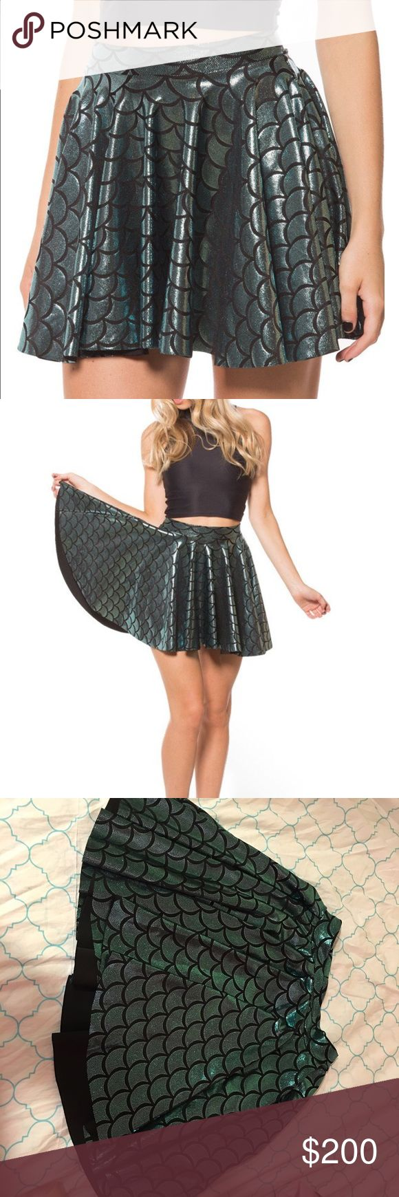 M mermaid cheerleader skirt black milk clothing Size M mermaid cheerleader skirt from black milk clothing! Very stretchy so can fit L too! Shiny, swishy, and fun - and retired from their website! Check my closet for more black milk :) Will take less on ️️ or swap for other BM, wildfox, or Unif  Blackmilk Skirts Circle & Skater