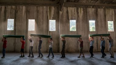 The coffins of some victims of the Srebrenica massacre are carried to the Potocari cemetery in July 2016. Over its ...