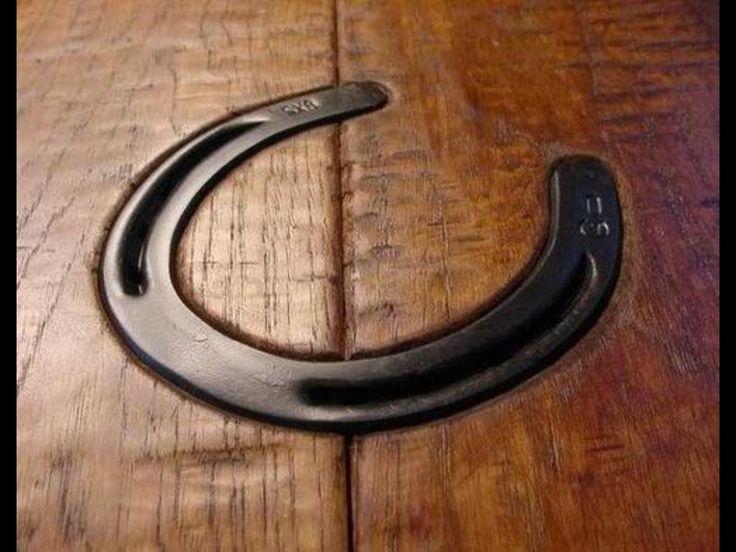 Horse shoe in bedded in the hardwood floor.