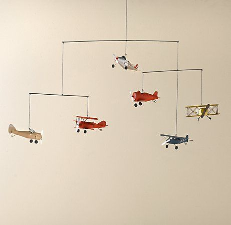 "Vintage Airplane Mobile... ""Multi-colored models of six WWI-era aircrafts wing their way to victory across the bedroom sky, capturing the attention of Allies young and old.""                                                                                                                                                      More"