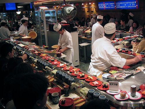 Sushi Kaiten.  Sushi on a conveyor belt.