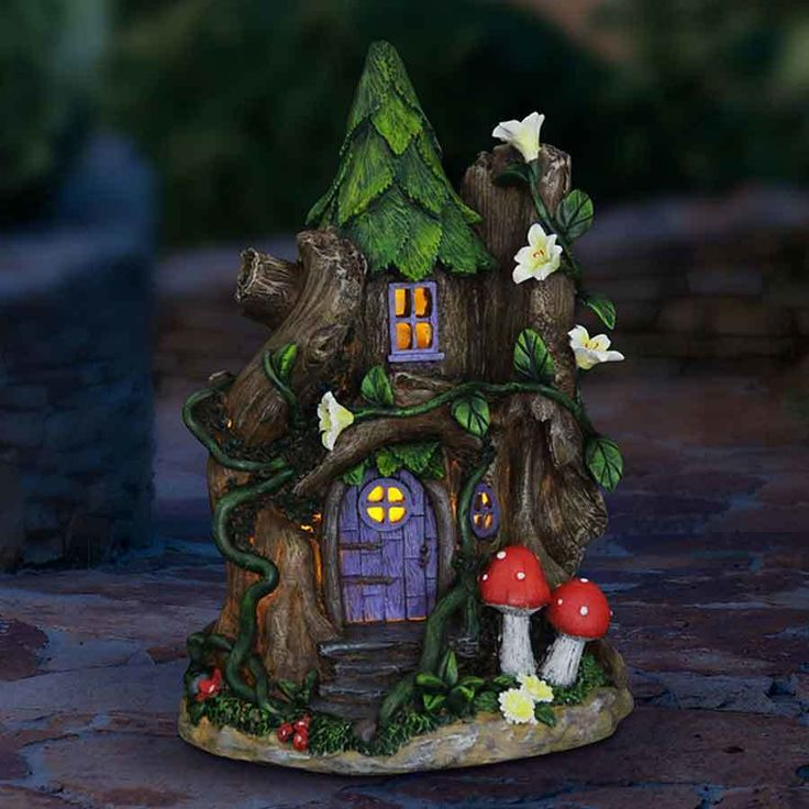 Fairy Homes and Gardens - Purple Door Solar Fairy House, $40.79 (https://www.fairyhomesandgardens.com/purple-door-solar-fairy-house/)