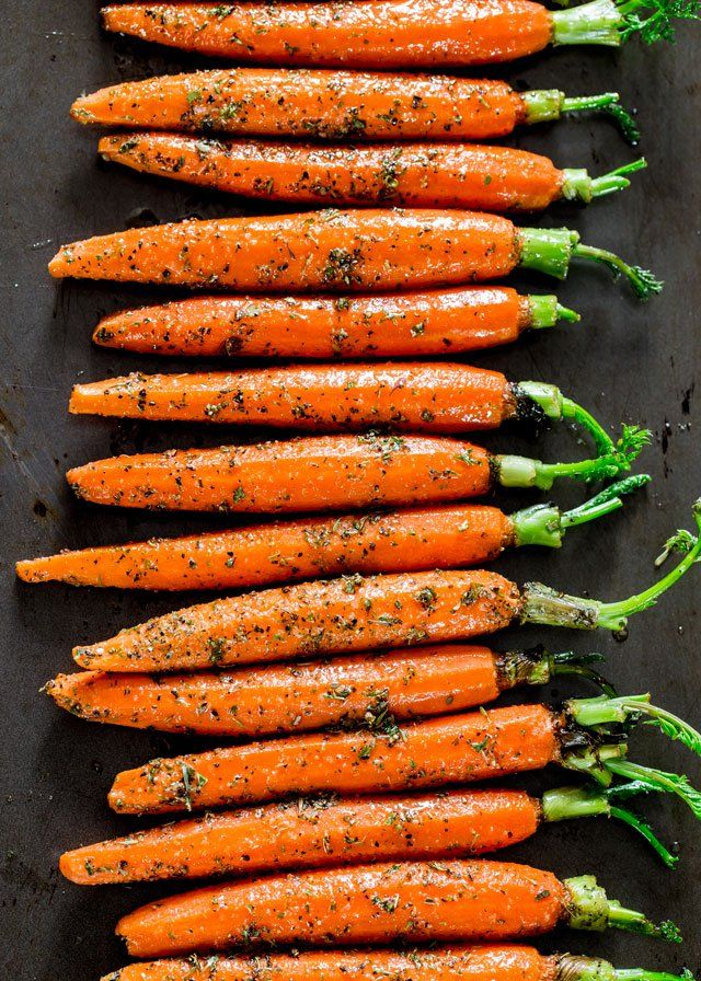 Garlic and Herb Roasted Carrots - these carrots are roasted to perfection with lots of garlic and herbs such as thyme, basil and oregano, creating the perfect side dish.