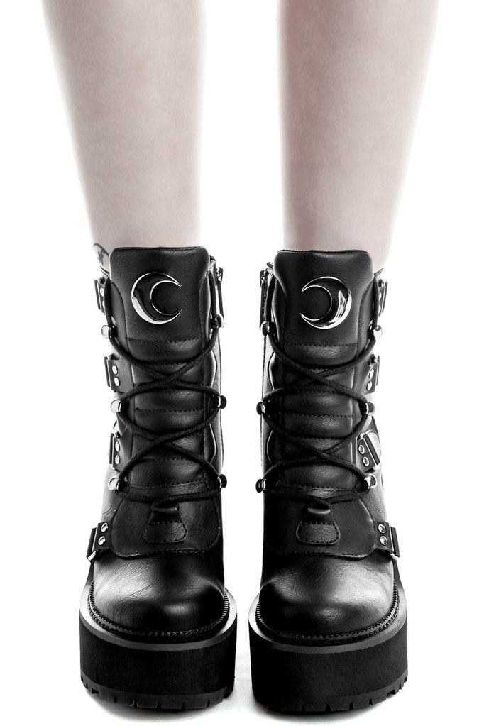Broom Rider Boots [B] | KILLSTAR You're a day dreamer and a night thinker; 'Broom Rider' boots come in a luxe faux leather, crescent moon hardware, lace feature and high platform - giving you just the right amount of elevation. Ready to rock with yer coven, nights out - or just doing day-to-day adventures.