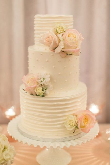 A gorgeous cake on a pretty milk glass cake stand.  Source: pinterest #milkglass #weddingcake #cakestand