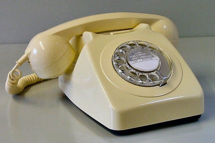 Rotary table-top phone. Kid will never know the satisfaction of slamming the phone down.