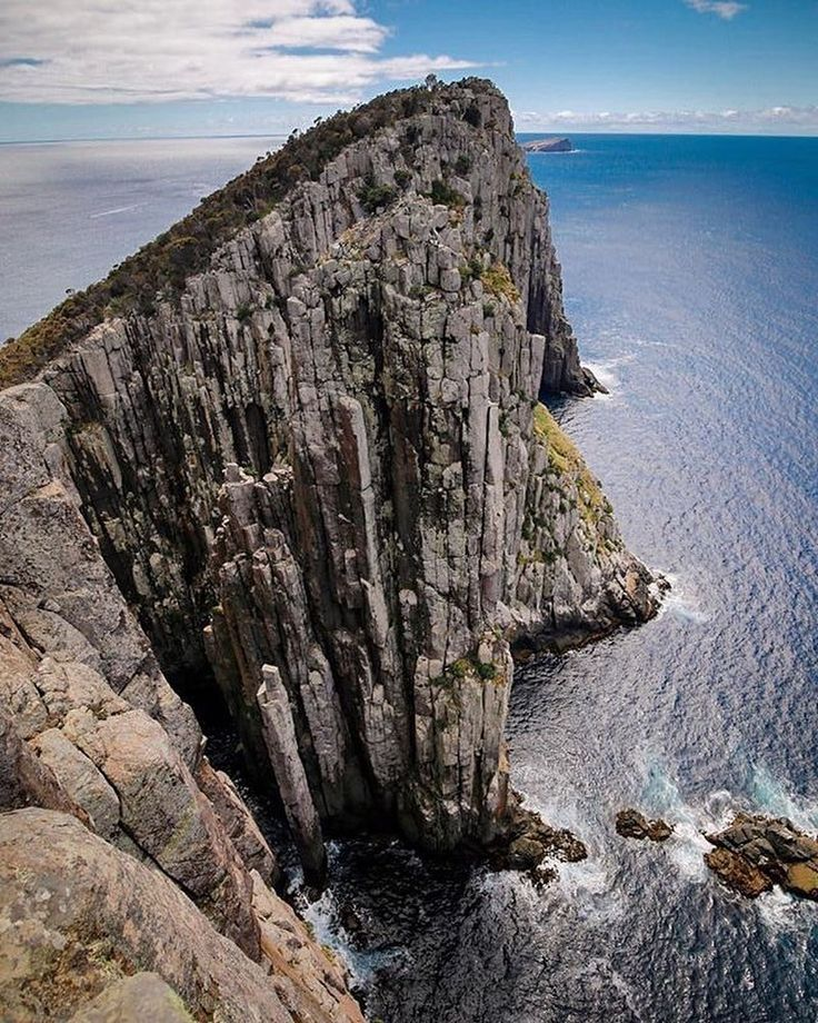 "Where's the most unbelievable coastline you've ever seen? Love this shot by @kate_miles_ at Cape Hauy Tasmania who says: ""Looking down to the Totem Pole and across to the Candlestick. We hoped we'd come across some crazy climbers attempting these famous routes but we were unlucky! Looking down to the ocean below I'd not want to be swimming across there no matter how good the climbing! You can hike to this beautiful lookout both as part of the Three Capes Track or as a day hike from Fortescue…"