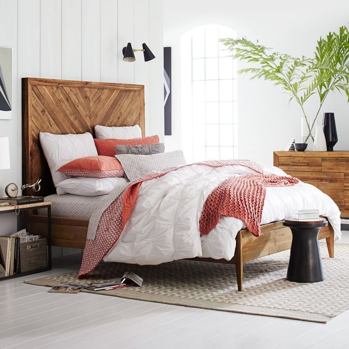 Sustainability and comfort. Crafted from reclaimed pine, our Alexa Bed imparts sophistication to naturalist style with its gently tapered legs and a sky-high headboard with chevron wood-grain pattern.