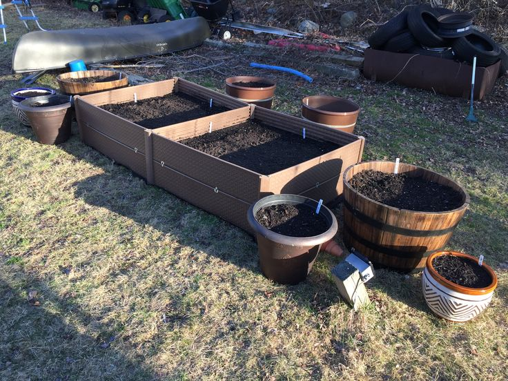 This is my very first attempt at gardening.  Starting out with a cheap raised bed kit and a few containers.