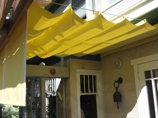 DIY pergola shades - perfect!  Up in the summer  cleaned/stored for the winter.