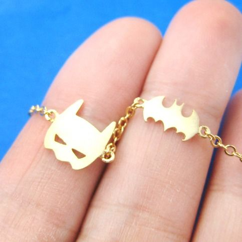 Classic Batman Bat Logo and Bat Mask Shaped Charm Bracelet in Gold from DOTOLY I'll take mine in Silver plz