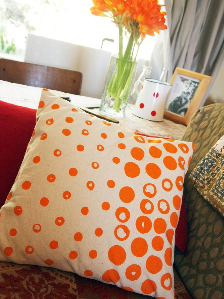 Dipped Dot Cushion Cover.  Orange on Natural, but also available in Grey on Natural.