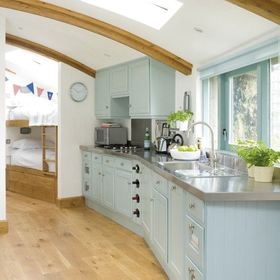 This bespoke kitchen makes the most of the interesting shape of the room while a skylight ensures this unqiue space remains light and bright