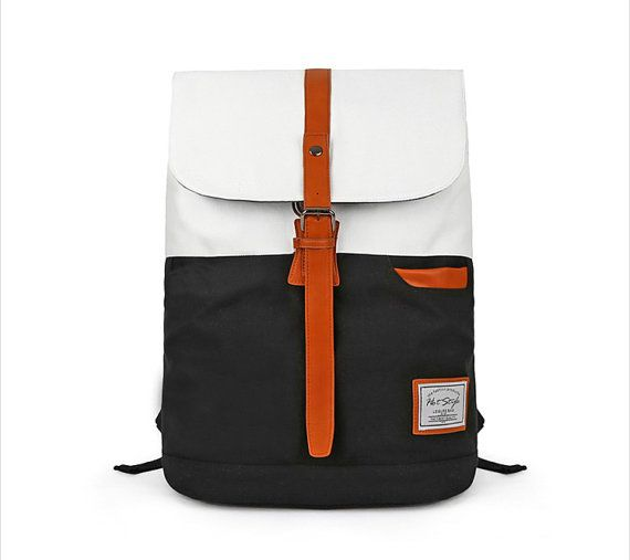 Color Block Backpack ideal for school, travel or any other occasions, has laptop sleeve, maximum laptop size that fits into it will be 15.6.