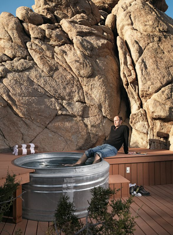 """Nighttime hikes often end at the the """"cowboy"""" hot tub where Smith soaks his feet: two nested Hastings galvanized livestock feeders. The tub is surrounded by a Veranda faux-wood deck and fed with hot water from the house's solar hot-water system."""