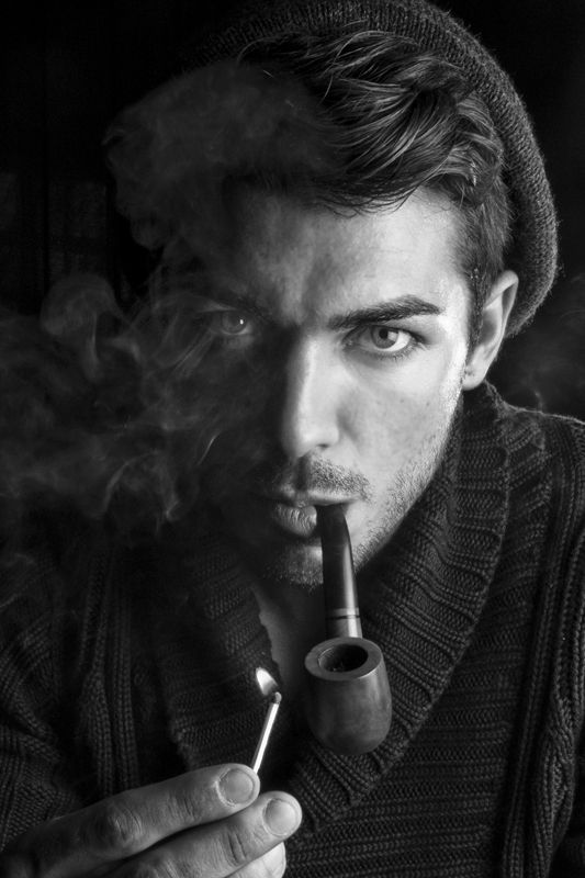Question young men smoking pipes are