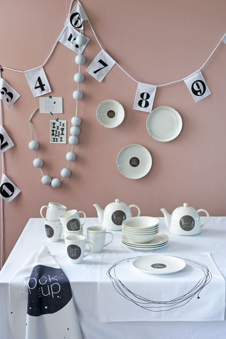 Dining table with mugs, teapots and crockery. The plates can also be used as an accessory on the wall together with the pendulum and beads chain | Styling Fietje Bruijn | Photographer Dennis Brandsma | vtwonen catalog autumn 2015 | #vtwonencollectie