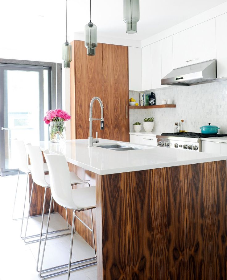 A gutsy renovation decision affords these Vancouver homeowners a highly functional, modern kitchen.