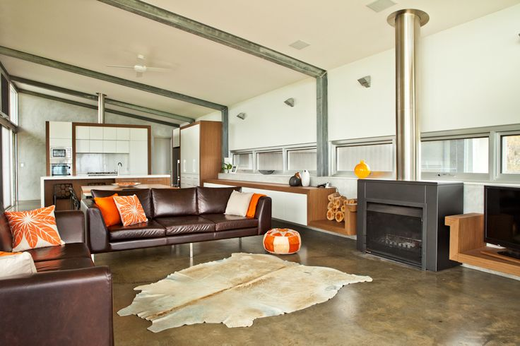 The Contemporary Weekender by Twinkle & Whistle (for Scoop Magazine) - Living Room: polished concrete floors, steel beams, dark leather couches - Craig Steere Architects