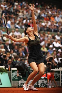 Maria Sharapova of Russia serves during the French Open at Roland Garros 2012