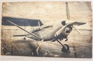Photo transfer onto wood!    An EASY DIY tutorial for how to create this stunning airplane art for a baby boy nursery or a big boys aviator theme room.