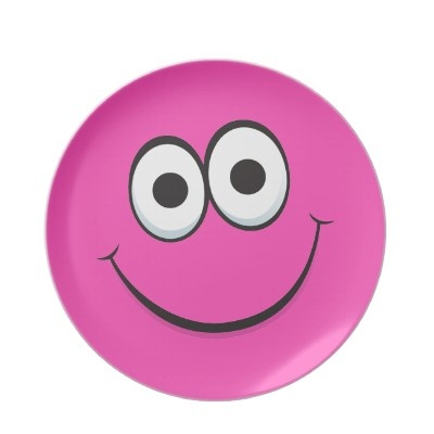 """""""Melamine plate featuring a happy, pink cartoon smiley face character with a big, happy smile. Cute and fun novelty design, great for girls. Available in different colors."""""""
