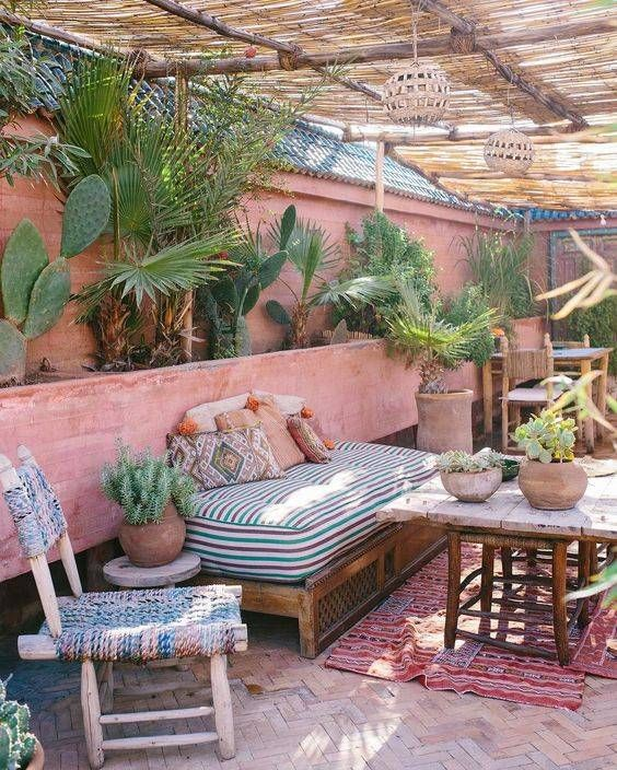 A Moroccan inspired outdoor living space. Beautiful kilim cushions with lots of greenery and terracotta hues