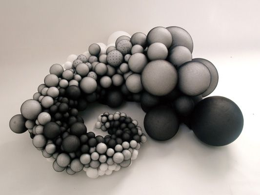 Abstract Fabric Sculpture by Rowan Mersh commissioned by The Jerwood Foundation for the Jerwood Contemporary Makers show, London, 2010. An exploration into tonal shading of a sculptural form. Created from stretch jersey and synthetic balls. Measuring 110cm in length and 5cm to 40cm in width.