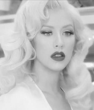 Christina Aguilera beautiful. Red lips, great hair, great skin....so pretty!