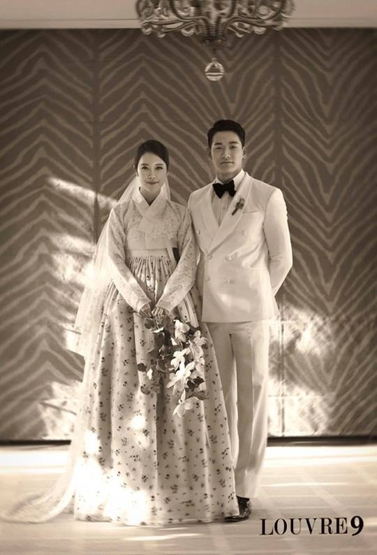 For this photo, the hanbok was done by Cha-E's Kim Young Jin, and the makeup and hair were done by Park Chul. The flowers were arranged by Helena.  The couple will tie the knot at the Sheraton Grande Walkerhill Hotel on June 2. The wedding ceremony will be hosted by 'I Am A Singer's PD Kim Young Hee and actor Kim Sung Soo. The congratulatory songs will be sung by Sung Shi Kyung and Leessang, while the reception will be hosted by Kim Chang Ryul with performances by Moon Myung Jin and Kim Bum…