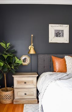 A master bedroom gets a high contrast dark and moody makeover with Sherwin-Williams Iron Ore #Modernfarmhouse