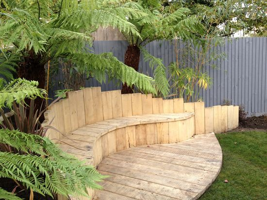 I love this covered corner bench area. Garden Design | ... London garden design tropical-garden-design-London – Gard